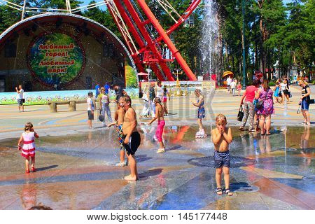 Kharkiv / Ukraine. 07 August 2016: children rescued from the heat by bathing in fountains Gorky Park in Kharkiv.  07 August 2016 in Kharkiv / Ukraine.