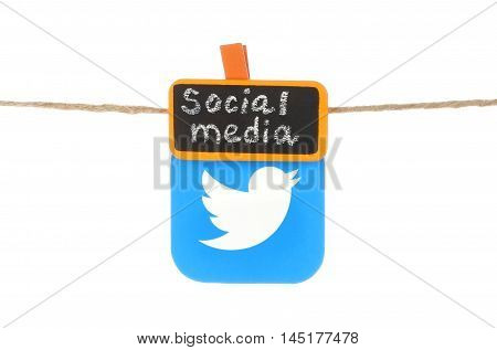 Kiev Ukraine - August 02 2016: Twitter icon printed on paper hangind on a rope with tag orange clothespin with chalk written words