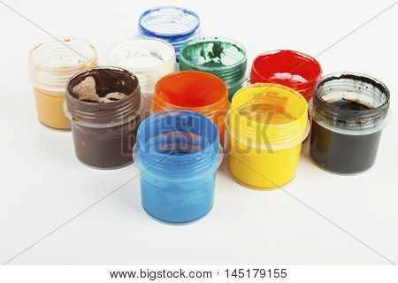 Jars with a colorful paint gouache. Stock Image macro.