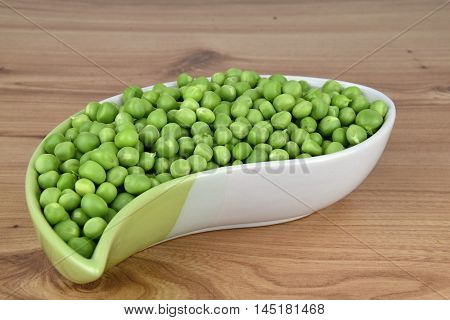Green peas in a ceramic bowl. Green peas