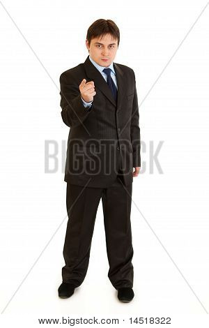Wrathful modern businessman pointing finger at you isolated on white