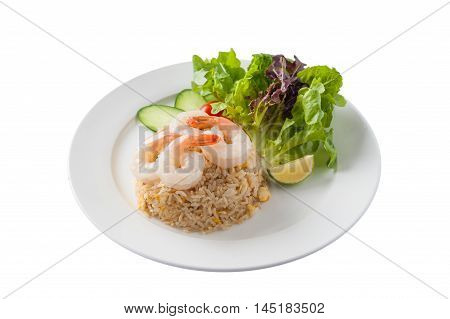 Front view of Thai style cuisine fried rice with shrimp garnished with vegetables in ceramic dish isolated on white background