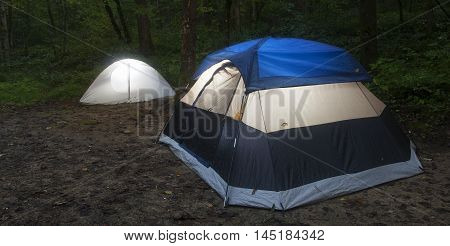 Two nylon tents pitched in North Carolina in dark light
