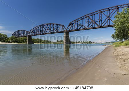 A railroad bridge crossing the Missouri River.