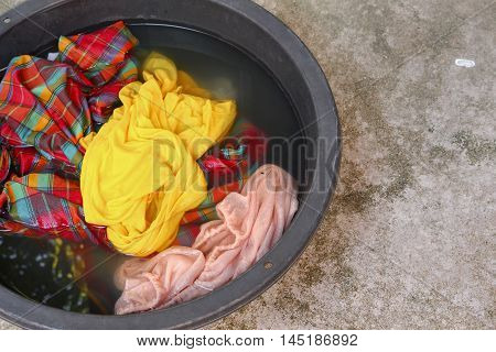 Soak dirty clothes in the basin black for clean, Thailand washing clothes style ancient