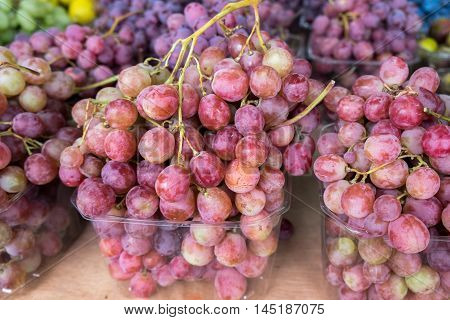 Red grapes for sale at city farmers market