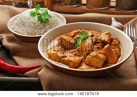 Tasty dinner with chicken curry in plate on tray