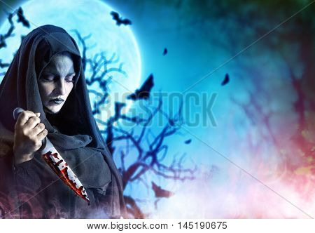 Murderer Woman With Bloody Knife In Halloween Satanic Night