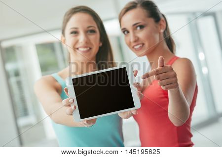 Cheerful Girls Showing A Tablet