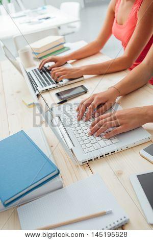 Students Doing Homeworks At Desk