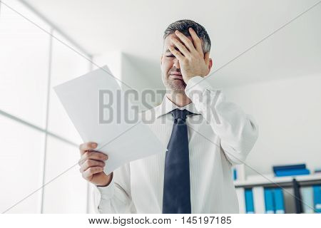 Office Worker Receiving A Dismissal Letter
