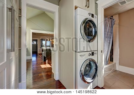 Photo Of Built-in Laundry Appliances In Bathroom