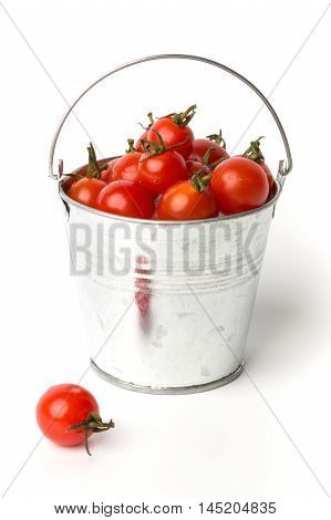 Fresh tomatoes in a pail isolated on white background