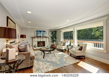 Cozy Living Room Interior With Hardwood Floor And Window View.