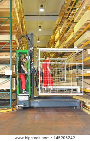 Side Loading Forklift With Basket in Timber Warehouse