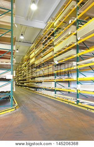 Timber Wood Building Material at Shelves in Warehouse