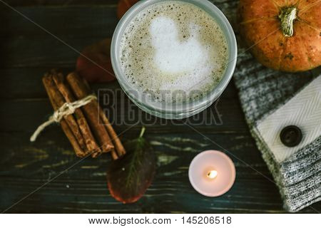 Blue Cup With Spicy Pumpkin Latte On A Wooden Board With A Sweater
