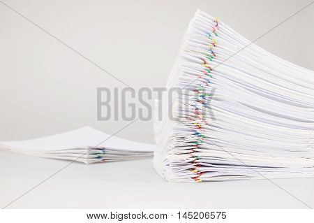 Pile Overload Paperwork With Colorful Paperclip With Blur Pile Document
