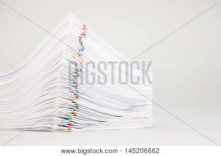 Pile Overload Paperwork With Colorful Paperclip Place On White Background