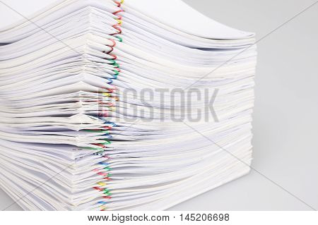 Pile Overload Paperwork With Colorful Paperclip On White Background