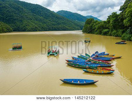 Colorful small boats on Phewa Lake in Pokhara, Nepal
