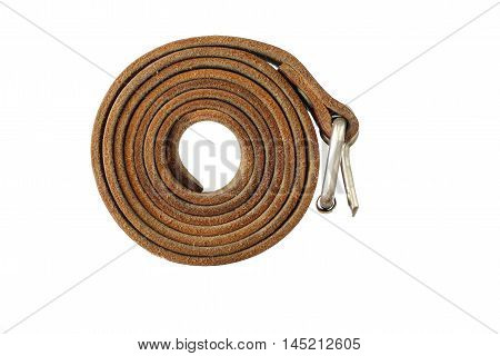 Coiled leather belt on a white background - tighten the belt