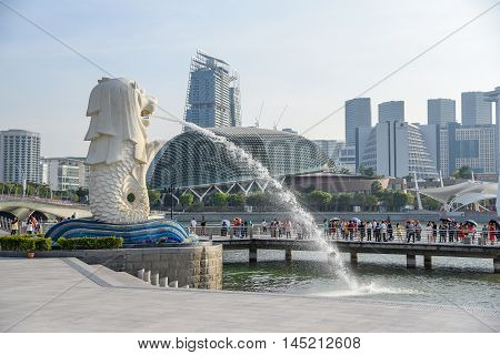 SINGAPORE - MAY 6 2016 : Tourists visit the Merlion Park a famous symbol of Singapore.