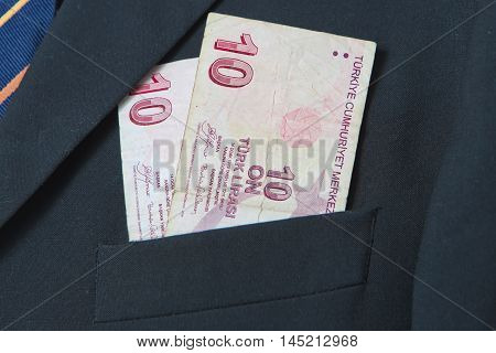 Turkish Lira in the pocket of a suit