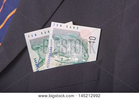 South african Rands in the pocket of a suit