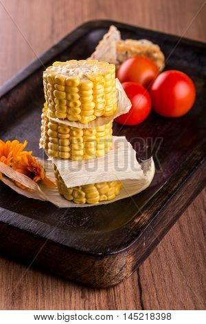 Few Portions Of Sweet Corn On A Stack On Wooden Plate
