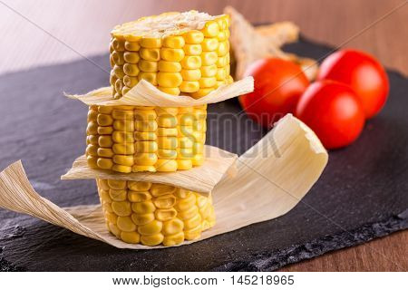 Stack Of Sweet Corn Portions On Slate Stone Plate