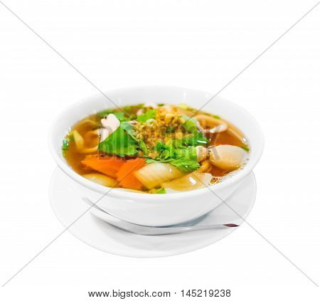 Hot and spicy Thai Dishes. A savoury thick soup made with squid rings spices and vegetables and crushed peanuts isolated on white background. Selective focus