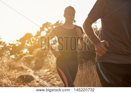 Young Concentrating Girl Running Behind Friend