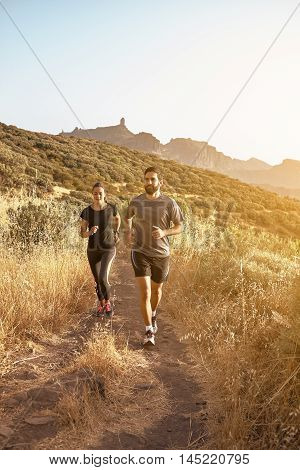Couple Running With Mountains In The Background