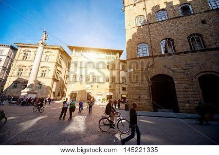 Florence, Italy - May 25, 2016: Crowded Holy Trinita square with an ancient Roman column known as the Column of Justice in Florence.