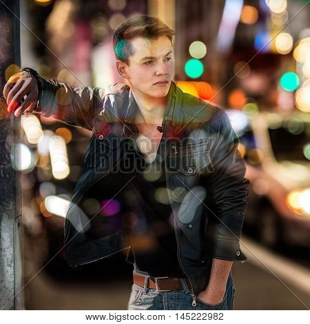 Fashion man in blurred background of New York night car traffic. Double exposure.