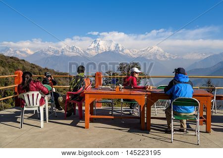 GOREPANI NEPAL - APRIL 10 2016 : Trekkers chill out and see Dhaulagiri mountain from viewpoint at Gorepani village Annapurana loop trekking route Nepal.