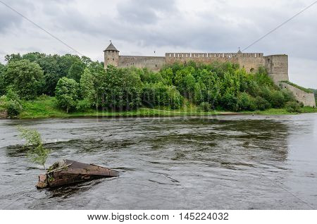 Ivangorod, Russia - August 13, 2016: The 15th century' built Russian Ivangorod fortress faces the Swedish (now Estonian) Narva fortress founded in the 1300s