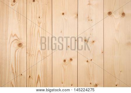 Wood panel background untreated light wood close-up.