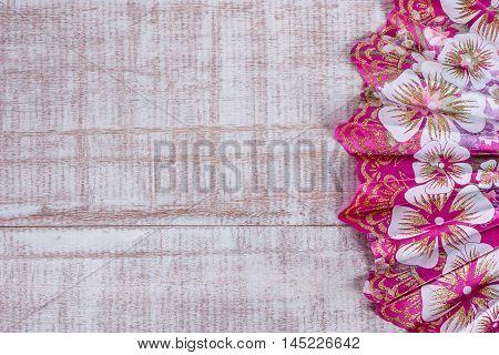 Flat lay manual hand fan on wood background