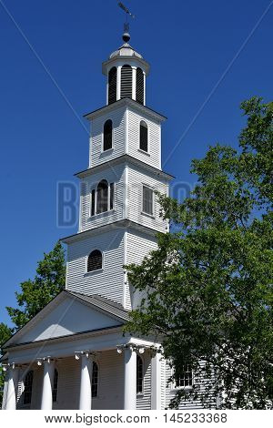 New Bern North Carolina - April 24 2016: 1822 First Presbyterian Church with tiered steeple and entrance portico on New Street