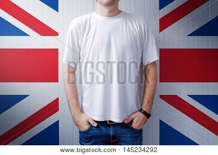 Man standing in front of United Kingdom flag wall adult male person supporting Great Britain