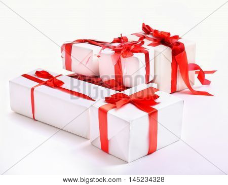 stack of red gift boxes decorated with bow isolated on white