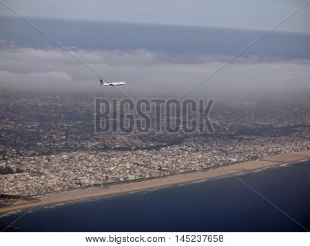LA - JULY 26: United Airlines Plane flies way from the City of LA. View of Beach and surrounding city area. LA on July 26 2012.