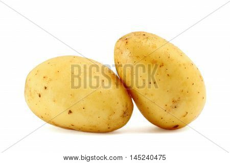 Two fresh potatoes isolated on white background