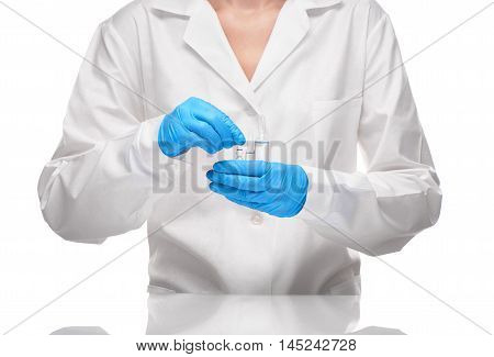 Doctor In Gown And Gloves Holding Glass Ampoules With Drug