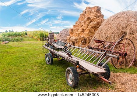 carts near the haystacks in the village