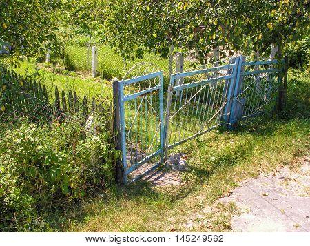Rickety iron gate on the small plot