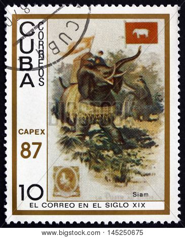CUBA - CIRCA 1987: a stamp printed in Cuba shows Messengers Ridding Elephants Thailand 19th Century Mail Carrier Pictured on Cigarette Card circa 1987