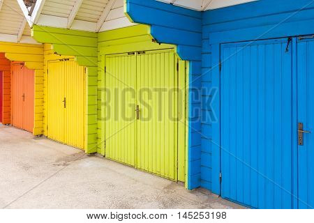 Colourful wooden beach huts at the seaside